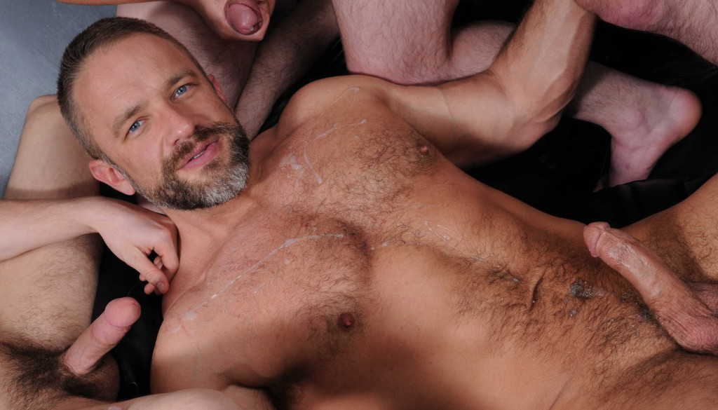 Dirk Caber bottoms for Scott Harbor Trevor Spade and Johnny Rapid in the gay porn series Stepfathers Secret by Jizz Orgy.