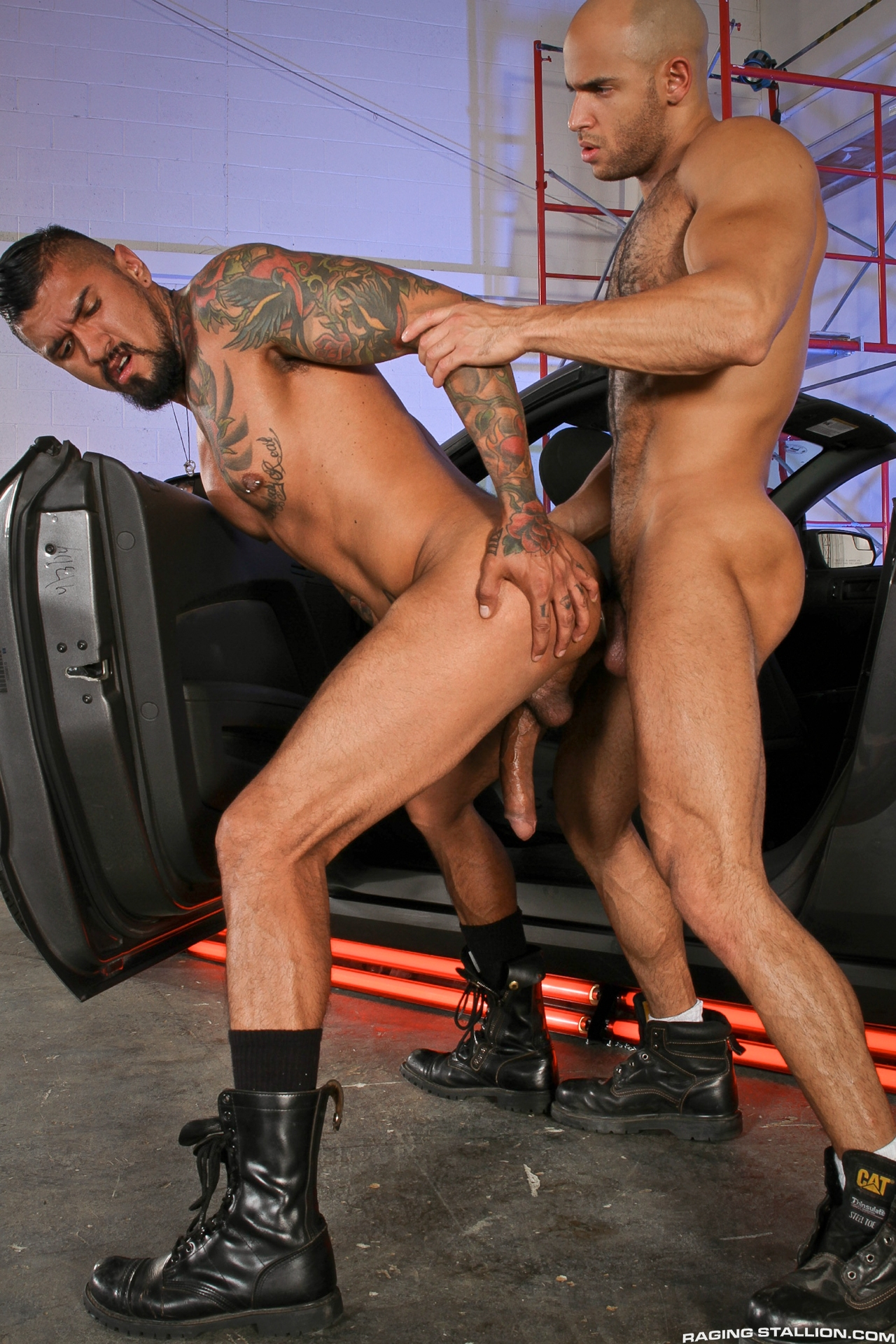 Boomer Banks bottoms for Sean Zevran in a flip-fuck from the gay porn film Auto Erotic by Raging Stallion.