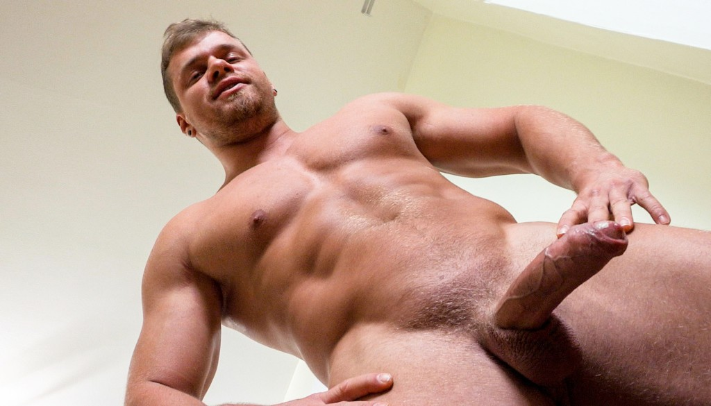 Brad jerks off his thick uncut cock in a gay porn solo for Maskurbate.